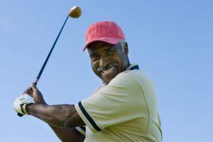 golfer smiles on backswing